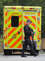 © Licensed to London News Pictures. 14/08/2018. London, UK. Armed police outside St Thomas's hospital in Westminster after a car crashed into security barriers in Parliament Square. Photo credit: Rob Pinney/LNP