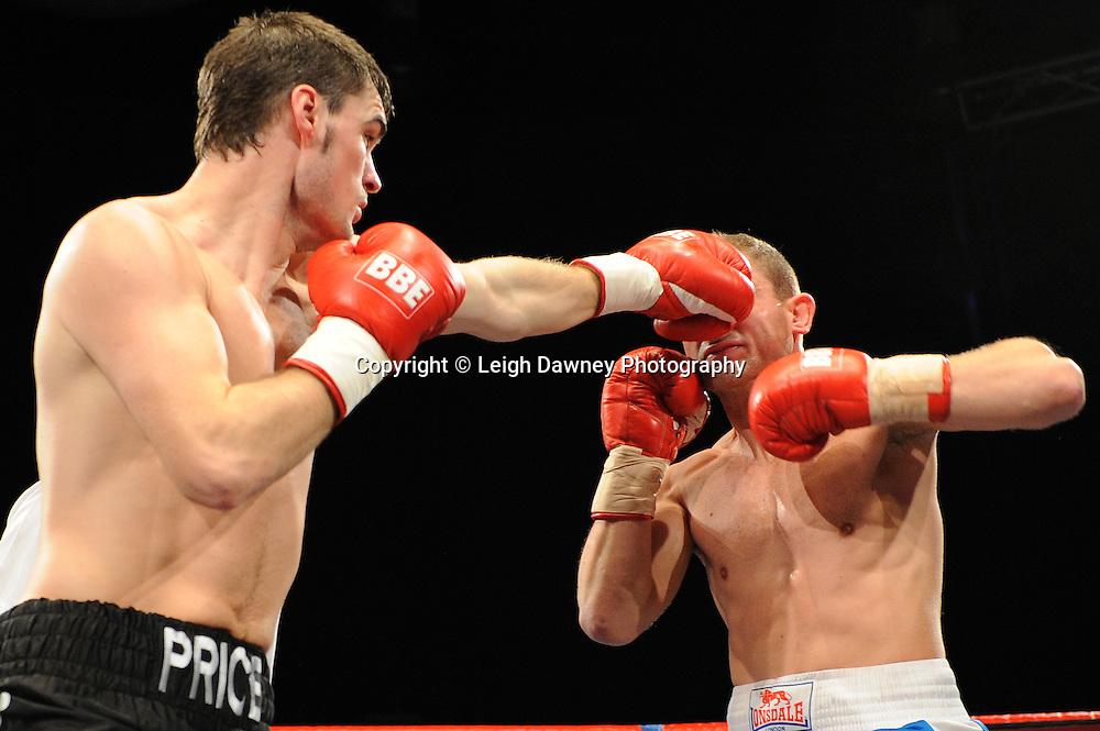 Danny Price (black shorts, pro debut fight) defeats Michal Tomko in a 4x3 Cruiserweight contest at the Premier Suite, Reebok Stadium, Bolton, UK on 22.10.11. Frank Maloney Promotions. Photo credit: © Leigh Dawney.