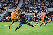 Houston Dynamo forward Mauro Manotas (9) takes a shot on goal with LAFC defender Mohamed El-Munir (13) defending during a MLS soccer game, Saturday, Sept 25, 2019, in Los Angeles. LAFC wins 3-1. (Jon Endow/Image of Sport)
