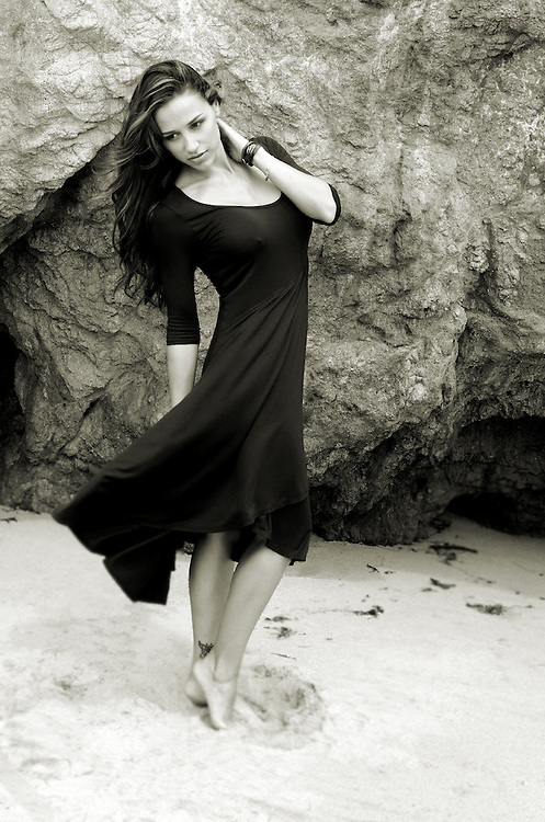 Fashion photography for Athletica Fitness Apparel. Black dress at El Matador State Beach in Malibu, CA.