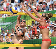 STARE JABLONKI POLAND - July 6: Karla Borger of Germany   and Whitney Pavlik of USA in action during Day 6 of the FIVB Beach Volleyball World Championships on July 6, 2013 in Stare Jablonki Poland.  (Photo by Piotr Hawalej)