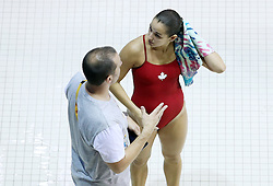 TORONTO, ON - JULY 12:  Pamela Ware of Canada speak to her coach Aaron Dvizer after competing in the Women's 3m Springboard Prelims during the Toronto 2015 Pan Am Games at the CIBC Aquatic Centre on July 12, 2015 in Toronto, Ontario, Canada.  (Photo by Vaughn Ridley/Canada Diving)
