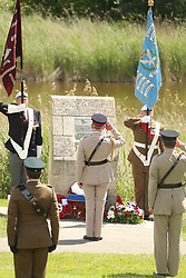 © Licensed to London News Pictures. 05/06/2014. Ranville, UK The Prince of Wales, accompanied by the Duchess of Cornwall, laid a wreath at Pegasus Bridge in Ranville, where British soldiers began the invasion after landing in gliders at 00.16am on June 6, 1944. . Photo credit : Jason Bryant/LNP