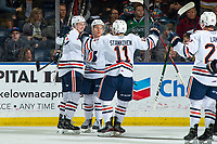 KELOWNA, BC - NOVEMBER 16: Brodi Stuart #17, Logan Stankoven #11 and Luke Zazula #7 of the Kamloops Blazers celebrate a first period goal against the Kelowna Rockets  at Prospera Place on November 16, 2019 in Kelowna, Canada. (Photo by Marissa Baecker/Shoot the Breeze)
