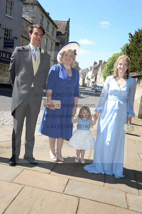 The brides family VISCOUNT ERLEIGH, the MARCHIONESS OF READING, LADY SYBILLA HART and her youngest daughter at the wedding of Lady Natasha Rufus Isaacs to Rupert Finch held at St.John The Baptist Church, Cirencester, Gloucestershire, UK on 8th June 2013.