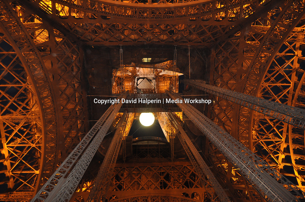 Eiffel tower, illuminated, evening, underside detail