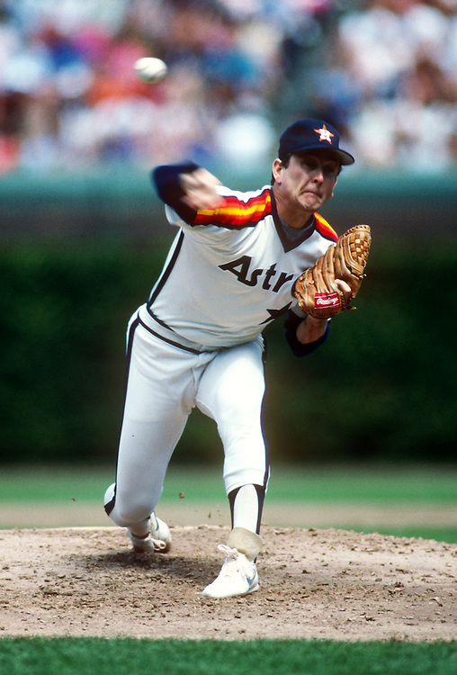 CHICAGO - 1987:  Baseabll Hall of Fame member Nolan Ryan of the Houston Astros pitches against the Chicago Cubs during an MLB game at Wrigley Field in Chicago, Illinois.  Ryan played for the Astros from 1980-1988. (Photo by Ron Vesely)