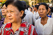 "30 JANUARY 2013 - PHNOM PENH, CAMBODIA:   Cambodians stop in front of the National Museum in Phnom Penh to look at the cremation site for late Cambodian King Norodom Sihanouk. Sihanouk (31 October 1922 - 15 October 2012) was the King of Cambodia from 1941 to 1955 and again from 1993 to 2004. He was the effective ruler of Cambodia from 1953 to 1970. After his second abdication in 2004, he was given the honorific of ""The King-Father of Cambodia."" Sihanouk held so many positions since 1941 that the Guinness Book of World Records identifies him as the politician who has served the world's greatest variety of political offices. These included two terms as king, two as sovereign prince, one as president, two as prime minister, as well as numerous positions as leader of various governments-in-exile. He served as puppet head of state for the Khmer Rouge government in 1975-1976. Most of these positions were only honorific, including the last position as constitutional king of Cambodia. Sihanouk's actual period of effective rule over Cambodia was from 9 November 1953, when Cambodia gained its independence from France, until 18 March 1970, when General Lon Nol and the National Assembly deposed him. Upon his final abdication, the Cambodian throne council appointed Norodom Sihamoni, one of Sihanouk's sons, as the new king. Sihanouk died in Beijing, China, where he was receiving medical care, on Oct. 15, 2012. His cremation is scheduled to take place on Feb. 4, 2013. Over a million people are expected to attend the service.        PHOTO BY JACK KURTZ"