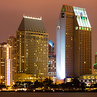 San Diego California downtown city buildings at night along the San Diego Bay.