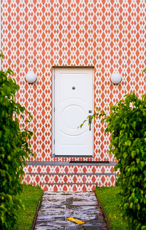 This mid-century, Miami Modern door treatment on a Miami Beach home resembles Op  Art from that period.