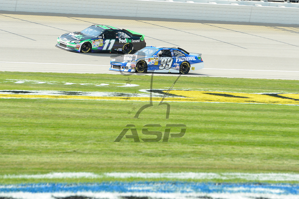 Joliet, IL - SEP 16, 2012: Denny Hamlin (11) and Carl Edwards (99) race during the Geico 400 at the Chicagoland Speedway in Joliet, IL.
