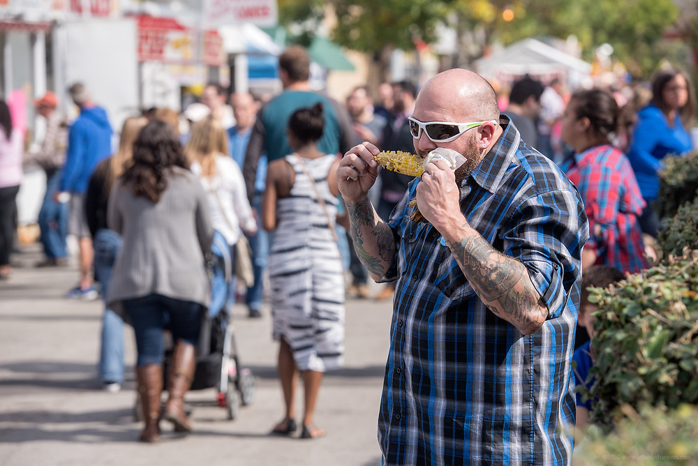 Scott Rager of Clarksville munches on corn-on-the-cob at the HotRod Harvest-themed 2015 Harvest Homecoming Festival in New Albany, Ind. Oct. 10, 2015