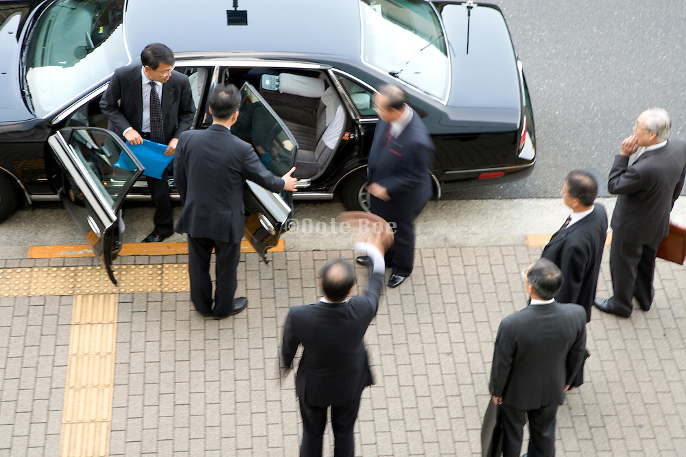 executive stepping in to a waiting limo Tokyo Japan