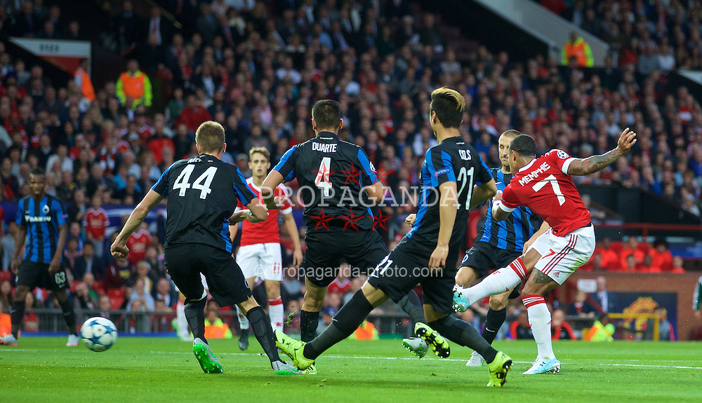 MANCHESTER, ENGLAND - Tuesday, August 18, 2015: Manchester United's Memphis Depay scores the first goal against Club Brugge during the UEFA Champions League Play-Off Round 1st Leg match at Old Trafford. (Pic by David Rawcliffe/Propaganda)