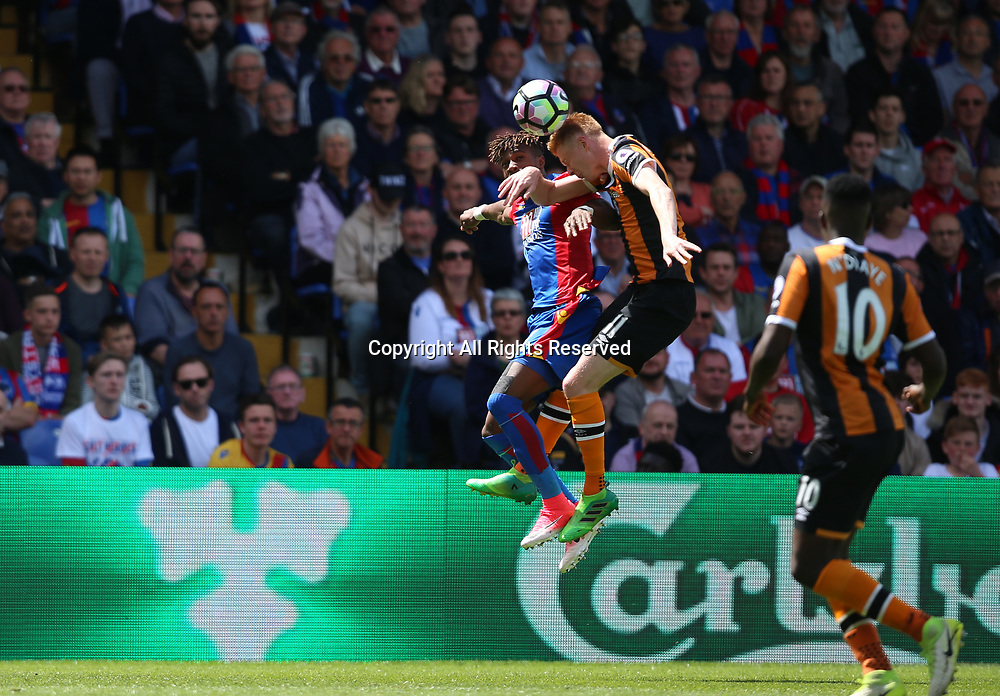 May 14th 2017, Selhurst Park, London, England; EPL Premier League football, Crystal Palace versus Hull Tigers; Wilfried Zaha of Crystal Palace and Sam Clucas of Hull City  jump to head the ball