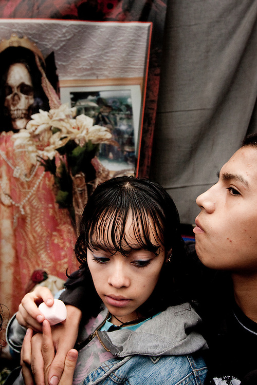 A teenage couple waits to enter the Tipito Sante Muerte Shrine in Mexico City