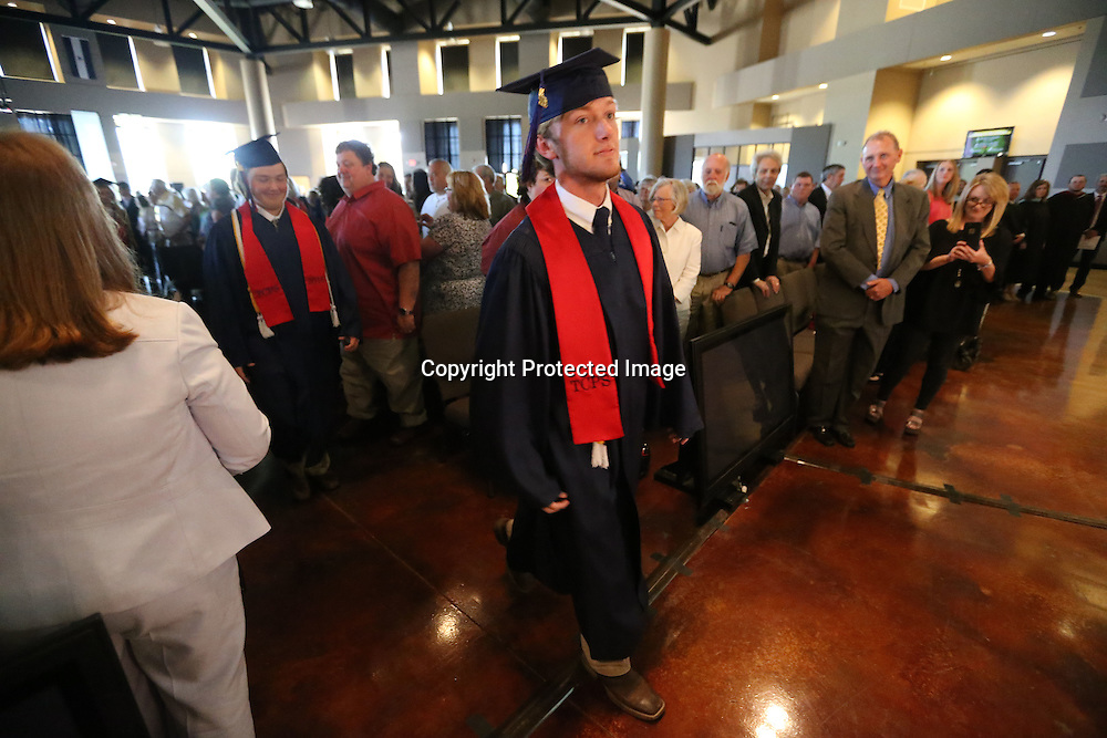 Adam Robison | BUT AT PHOTOS.DJOURNAL.COM<br /> The TCPS graduating class of 2016 enters the Orchard for their graduation ceremony on Saturday.