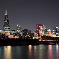 Chicago at night. Chicago skyline high resolution photo with Willis Tower (formerly Sears Tower) and Lake Michigan.