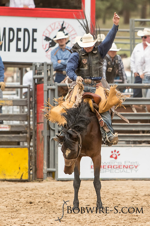 Saddle brond rider Joey Sonnier rides Summit Pro Rodeo's Pawnee Bill for a reride during the third performance of the Elizabeth Stampede on Sunday, June 3, 2018.