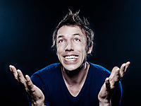 studio portrait on black background of a funny expressive caucasian man ecstatic