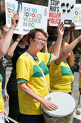 Kate Allen, the UK Director of Amnesty International, joins a group of demonstrators to protest declaring 'Say no to police violence in Rio', with a band of Samba drummers at Marble Arch in London.
