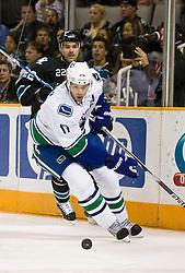 April 8, 2010; San Jose, CA, USA; Vancouver Canucks center Ryan Kesler (17) skates past San Jose Sharks defenseman Dan Boyle (22) during the first period at HP Pavilion.  San Jose defeated Vancouver 4-2. Mandatory Credit: Jason O. Watson / US PRESSWIRE