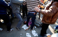 A dead child lays on the ground after a group of Mubarak supporters, some riding camels and horses, attempted to kill a group of anti-Mubarak protesters in Cairo, Egypt on Wednesday, Feb. 2, 2011.