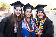 San Jose State students celebrate during the Child & Adolescent Development convocaton at San José State University's South Tower Hall Lawn in San Jose, California, on May 22, 2013. (Stan Olszewski/SOSKIphoto)