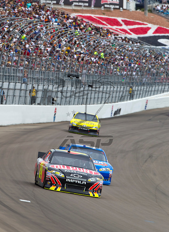 LAS VEGAS, NV - MAR 11, 2012:  Jeff Gordon (24) brings his car through the turns during the Kobalt Tools 400 race at the Las Vegas Motor Speedway in Las Vegas, NV.