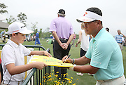 PGA golfer K.J. Choi signs an autograph for Tyler Korock, age 12 of Kingwood at the Golf Club of Houston on Tuesday, March 29, 2016 in Humble, TX. Korock and his family has attended the last four Shell Houston Open Championships. (Photo: Thomas B. Shea/For the Chronicle)