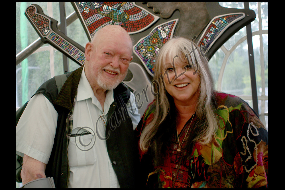 "Melanie and Charles Everest.-. To celebrate the 40th anniversary of the original Great Festival Melanie was invited back to the IOW. She performed a wonderful set, and Charles was delighted to present Melanie and John Giddings each with a copy of his original 1970 print.  .This photograph was taken in the media tent in front of Guy Portelli's ""Hey Joe"" sculpture.By kind permission of John Giddings, promoter and organiser of the 2010 Isle of Wight festival."
