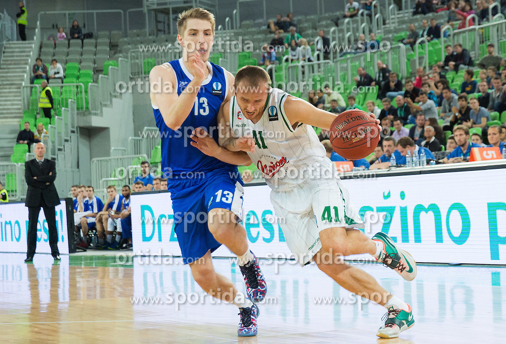 Artem Vikhrov of Zenit vs Marko Marinovic #41 of KK Union Olimpija during basketball match between KK Union Olimpija (SLO) and Zenit St. Petersburg (RUS) in 4th Round of EuroCup 2014/15, on November 4, 2014 in Arena Stozice, Ljubljana, Slovenia. Photo by Vid Ponikvar / Sportida