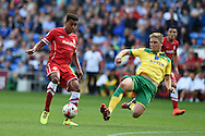 Tom Adeyemi of Cardiff city is fouled by Michael Turner of Norwich city for which he is booked. Skybet football league championship match, Cardiff city v Norwich city at the Cardiff city Stadium in Cardiff, South Wales on Saturday 13th Sept 2014<br /> pic by Andrew Orchard, Andrew Orchard sports photography.