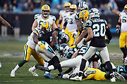 Carolina Panthers strong safety Mike Adams (29) gets tackled by Green Bay Packers rookie running back Jamaal Williams (30) after recovering a fumble by Packers wide receiver Geronimo Allison (81) late in the fourth quarter on a game winning play during the 2017 NFL week 15 regular season football game against the Carolina Panthers, Sunday, Dec. 17, 2017 in Charlotte, N.C. The Panthers won the game 31-24. (©Paul Anthony Spinelli)