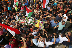 October 1, 2018 - Ramallah, West Bank, Palestinian Territory - Mourners carry the body of Palestinian Mohammed al-Rimawi, 24, who was died after Israeli forces beat him during raid on his family house on September 18, during his funeral in the West Bank village of Beit Reema, northwest of Ramallah.   (Credit Image: © Shadi Hatem/APA Images via ZUMA Wire)
