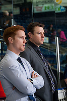 KELOWNA, CANADA - FEBRUARY 13: Seattle Thunderbirds' assistant coaches Tyler Alos and Matt O'Dette stand on the bench during warm up against the Kelowna Rockets on February 13, 2017 at Prospera Place in Kelowna, British Columbia, Canada.  (Photo by Marissa Baecker/Shoot the Breeze)  *** Local Caption ***