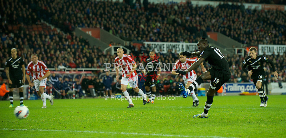 STOKE-ON-TRENT, ENGLAND - Monday, October 31, 2011: Newcastle United's Demba Ba scores the third goal against Stoke City from the penalty spot completing his hat-trick during the Premiership match at the Britannia Stadium. (Pic by David Rawcliffe/Propaganda)