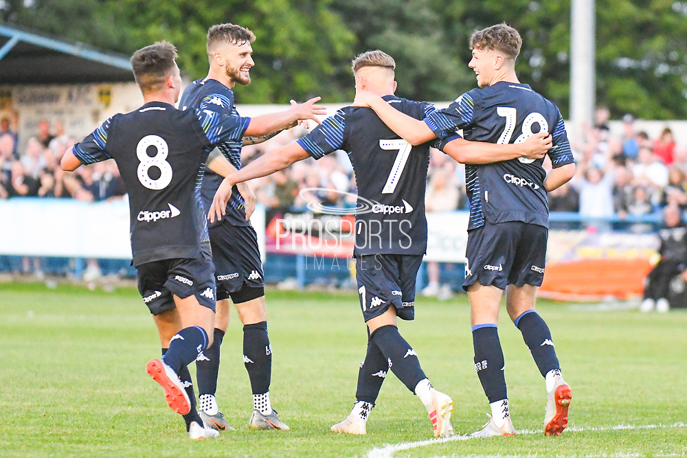 Leeds United midfielder Mateusz Bogusz (7) scores a goal and celebrates with Leeds United midfielder Mateusz Klich (6) to make the score 1-2 during the Pre-Season Friendly match between Guiseley  and Leeds United at Nethermoor Park, Guiseley, United Kingdom on 11 July 2019.
