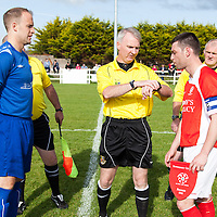 Ennis Towns Captain Stephen Hickey and Newmarket-on-Fergus Captain Michael Crosby with Referree Michael Rock tossing a coin before the Clare Cup Final 2014 at the county grounds, Ennis