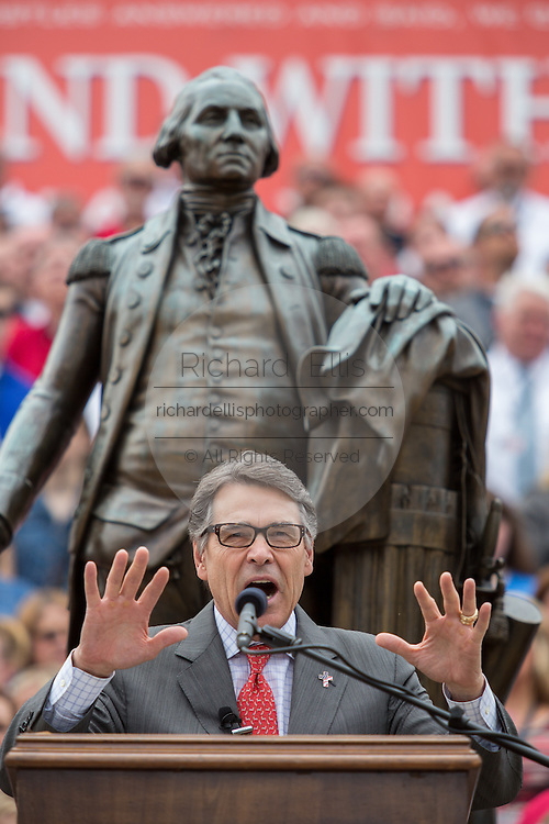 "Former Texas Gov. Rick Perry in front of a statue of George Washington, address a gathering of evangelical Christians during the ""Stand With God"" rally  August 29, 2015 in Columbia, SC. Thousands of conservative Christians gathered at the State House to rally against gay marriage and listen to GOP presidential candidates Gov. Rick Perry and Sen. Ted Cruz speak."