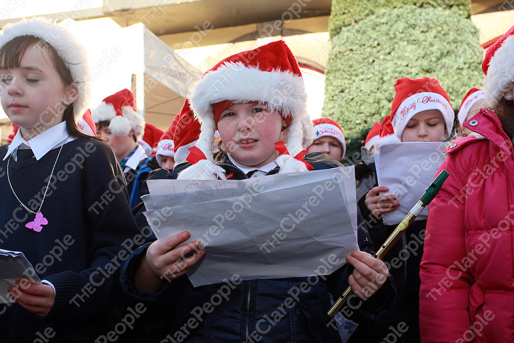 Micheale Ni Bhriain from Gaelscoil Ui Choinin carol singing in Kilrush on Thursday.<br /> Photograph by Yvonne Vaughan