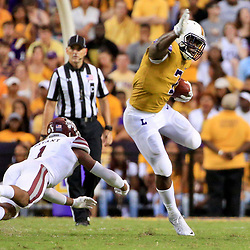 Sep 17, 2016; Baton Rouge, LA, USA;  LSU Tigers running back Leonard Fournette (7) avoids Mississippi State Bulldogs defensive back Brandon Bryant (1) on a run during the second quarter of a game at Tiger Stadium. Mandatory Credit: Derick E. Hingle-USA TODAY Sports