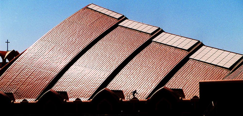 A maintenance man climbs to the roof of the Ebenezer Baptist Church in Atlanta