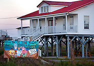 A hand-painted sign along Louisiana Highway 1 expresses Grand Isle residents' frustrations over the Deepwater Horizon BP oil spill Nov. 23, 2010. The barrier island, situated on the Gulf of Mexico at the southernmost tip of Louisiana, was heavily affected when the Deepwater Horizon oil rig exploded April 20, 2010, killing 11 workers and causing the largest offshore oil spill in United States history. (Photo by Carmen K. Sisson/Cloudybright)