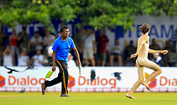 November 7, 2018 - Galle, Sri Lanka - A Streaker is chased down by a Sri Lankan who was preparing the pitch amid the playing area during the 2nd day's play of the first test cricket match between Sri Lanka and England at Galle International cricket stadium, Galle, Sri Lanka. 11-07-2018  (Credit Image: © Tharaka Basnayaka/NurPhoto via ZUMA Press)