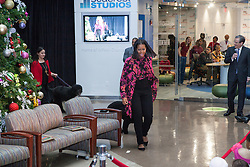 "December 12, 2016 - Washington, DC, United States - On Monday, December 12, First Lady Michelle Obama visited patients, families, and staff at Children's National Health System for the eighth consecutive year, and her last visit as First Lady, joined by TV and radio host Ryan Seacrest... ..Mrs. Obama and Mr. Seacrest accompanied by First Dogs, Bo and Sunny – arrived in the hospital's Main Atrium, escorted by Santa Claus, and two patients, Maryam Noor Ashard, 13, and Abi Soliman, 5. They greeted patients, families, and staff, and as part of Mrs. Obama's annual tradition, read the holiday classic 'Twas the Night before Christmas to the audience. The children in the audience asked the First Lady and Mr. Seacrest questions. Instructors and students from Just Rock Enterprises, the Amours vocal group, and Reggie Rice–the ""Super Magic Man""– treated children and families to a holiday concert complete with interactive songs and games... ..To complete the visit, Mrs. Obama and Mr. Seacrest visited Seacrest Studios in the Main Atrium to greet additional patients and participate in an interview that was broadcasted to patients throughout the hospital. Seacrest Studios was made possible in partnership with the Ryan Seacrest Foundation (RSF). The studio provides regular programming for patients in the hospital including games, talk shows, celebrity visits, and dance parties. (Credit Image: © Cheriss May/NurPhoto via ZUMA Press)"