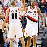 02 December 2013: Portland Trail Blazers power forward LaMarcus Aldridge (12) is congratulated by Portland Trail Blazers small forward Nicolas Batum (88) during the Portland Trail Blazers 106-102 victory over the Indiana Pacers at the Moda Center, Portland, Oregon, USA.