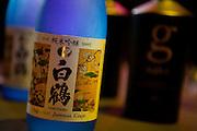 Hakutsuru Jummai Ginjo sake, with a bottle of G Genshu sake in the background.