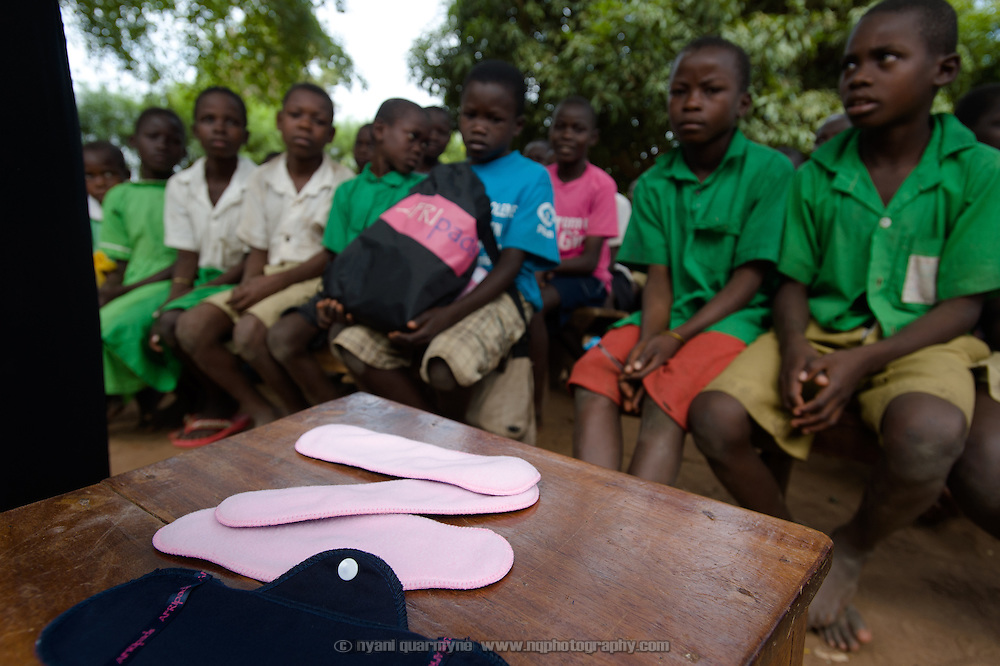 Afripads are seen on a chair as Lovisa Wankya, a teacher and an Afripads dealer, demonstrates the correct use of the pads to students at Achilet Primary School near Tororo in Eastern Uganda on 1 August 2014. Afripads are reusable fibre sanitary pads that are having a revolutionary impact on menstrual hygiene management, particularly amongst girls and women who cannot afford expesive disposable pads, and who previously had to use rags, cotton wool or toilet paper.