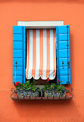 Window detail on colourful house in village of Burano near Venice in Italy